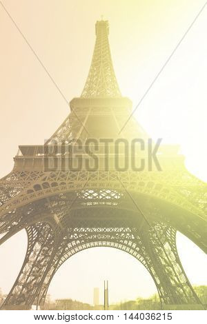 The Eiffel Tower in sunshine. Retro style filtred image