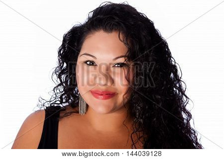Beautiful happy face of full plus sized latina with long curly hair beauty skincare makeup concept.