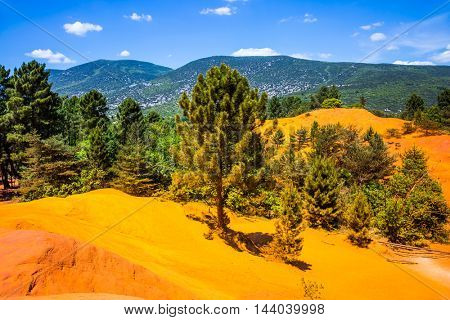 Quarry- reserve - for ocher mining. Languedoc - Roussillon, Provence, France. Orange and red picturesque hills