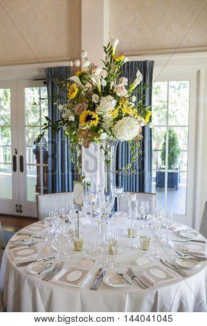 Elegant table arrangement for wedding reception