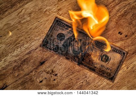 A banknote getting fire, it is burning