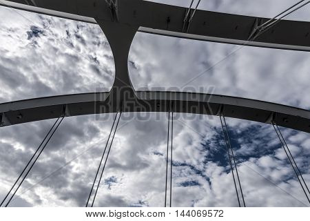 small white bridge structure details closeup closudy sky background
