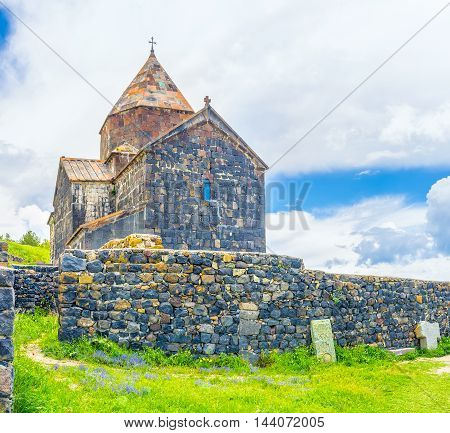 The massive stone fence in front of Surp Arakelots (Holy Apostles) Church of Sevanavank Monastery Sevan Armenia.