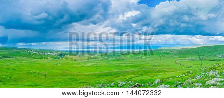 The rainy weather along the Selim pass with the view on the juicy green meadows and Sevan Lake on the distance Gegharkunik Province Armenia.