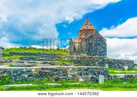 The black stone Surp Arakelots (Holy Apostles) Church of Sevanavank Monastery located on Sevan Peninsula Armenia.