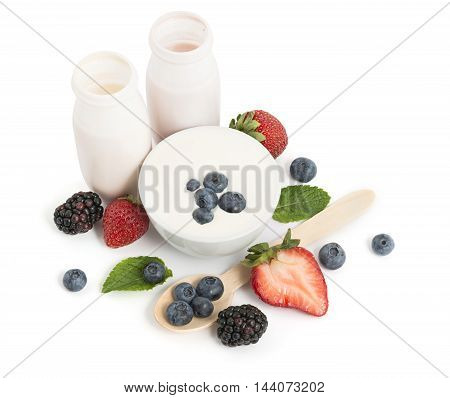Drinking yogurts berries and meant leaves on white background