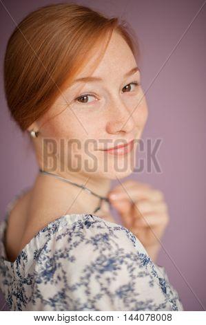 The portrait of russian beautiful redhead woman