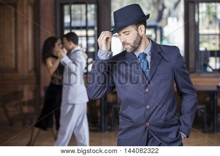 Tango Dancer Holding Hat While Partners Performing In Restaurant