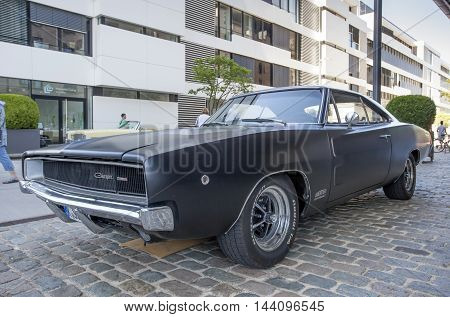 COLOGNE GERMANY - AUG 7 2016: Black Dodge Charger muscle car from ca. 1970 at an exhibition in the city of Cologne Germany