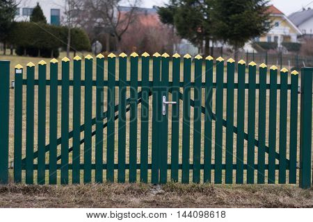 decorative gate from the fence for entrance and exit