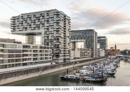 COLOGNE GERMANY - AUG 7 2016: The Crane Houses at the Rhine river in Cologne. The buildings are the contemporary landmark of the city. North Rhine-Westphalia Germany
