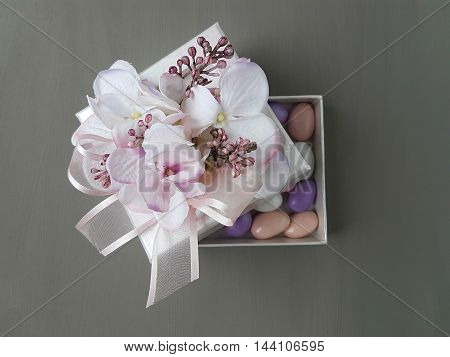 sugar coated almond candies in a box
