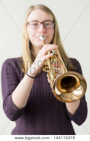 Teenager playing trumpet - Focus point instrument exempted