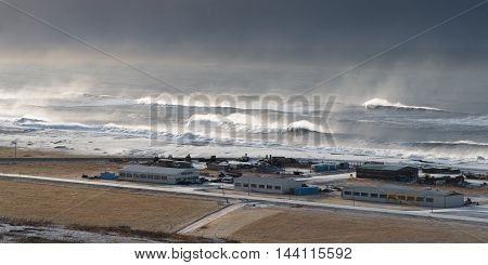 Rainstorm with big waves on the Atlantic ocean crashing on the coast at Vik village in southeast island of Iceland