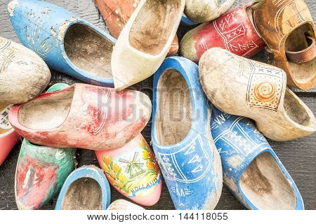Traditional wooden dutch shoes called clogs .