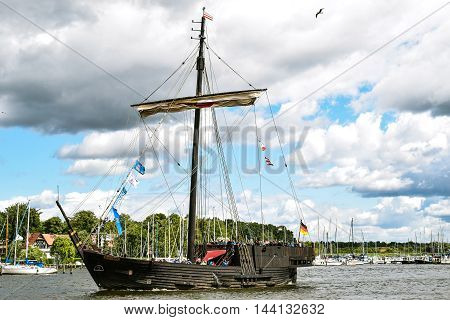 ROSTOCK, GERMANY - 12 AUGUST 2016: Medieval vessel Wissemara is sailing in Hanse-Sail Rostock, Germany