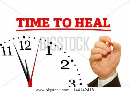 Businessman hand writing TIME TO HEAL message on a transparent wipe board.