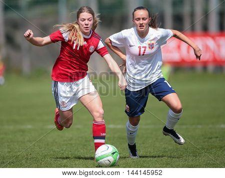 LINDABRUNN, AUSTRIA - APRIL 13, 2015: Freja Kjaersig Sunesen (#11 Denmark) and Andrea Wilmann (#17 Norway) fight for the ball during a UEFA women's U17 qualifying game.