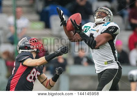 INNSBRUCK, AUSTRIA - APRIL 11, 2015: DB Talib Wise (#4 Raiders) catches the ball in a game of the Big Six Football League.