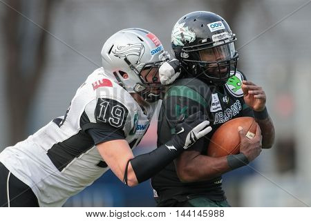 VIENNA, AUSTRIA - APRIL 4, 2015: LB Nic Haritonenko (#19 Raiders) tackles QB Alex Good (#7 Dragons) in a game of the Austrian Football League.