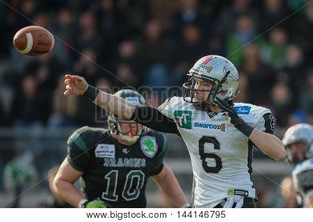 VIENNA, AUSTRIA - APRIL 4, 2015: QB Kyle Callahan (#6 Raiders) throws the ball in a game of the Austrian Football League.