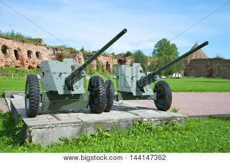 SHLISSELBURG, RUSSIA - AUGUST 01, 2016: Two anti-tank guns during the Second world war in the fortress Oreshek. A fragment of the memorial to the defense of the fortress in the Great Patriotic war