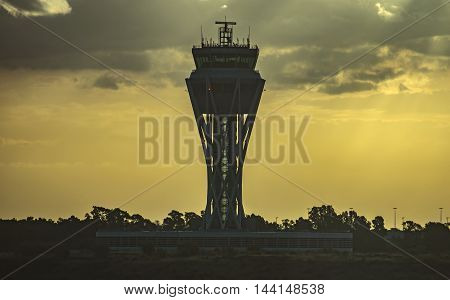 BARCELONA SPAIN - JULY 14 2016: The control tower of El Prat-Barcelona airport early morning. This airport was inaugurated in 1963.