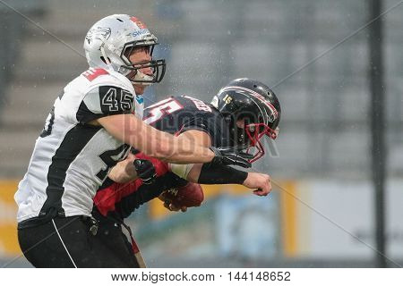 INNSBRUCK, AUSTRIA - APRIL 11, 2015: LB Roni Salonen (#45 Raiders tackles QB Manuel Engelmann (#15 Panther) in a game of the Big Six Football League.