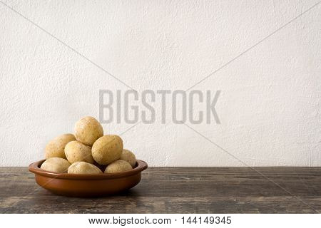 Canarian potatoes (papas arrugadas)  on wooden table