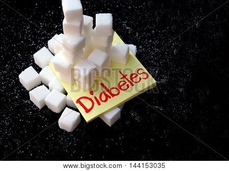 Diabetes health concept: sugar cubes stacked about to collapse.