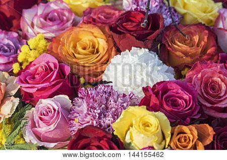 Festive Bouquet of roses and carnations in several colors