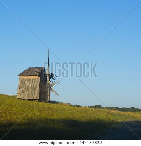 Old Traditional Wooden Windmill in Countryside Stock Photo
