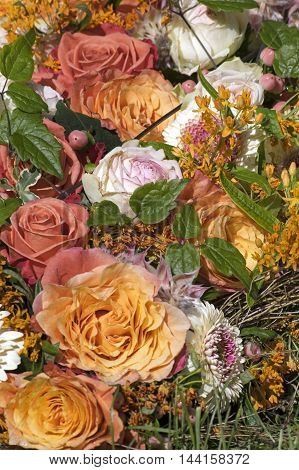 Bouquet with roses in several orange colors