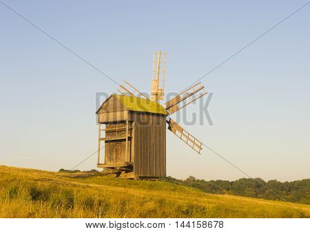 Old Traditional Wooded Windmill in Countryside Stock Photo
