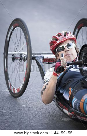 NEW YORK - JUL 24 2016: ParaTriathlete from CAF, Challenged Athletes Foundation, competes in the Panasonic NYC Triathlon, biking 40 kilometers mainly on the Henry Hudson Parkway.