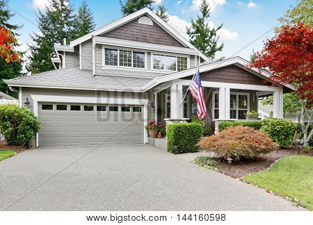 Nice Curb Appeal Of Grey House With Covered Porch And Garage