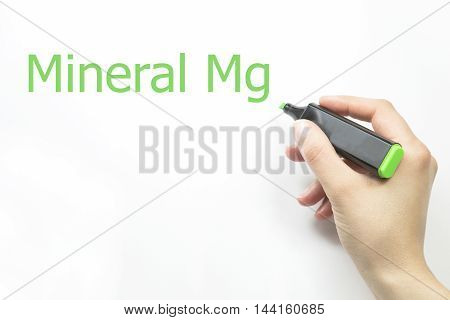Hand writing vitamin mg with green marker on transparent wipe board