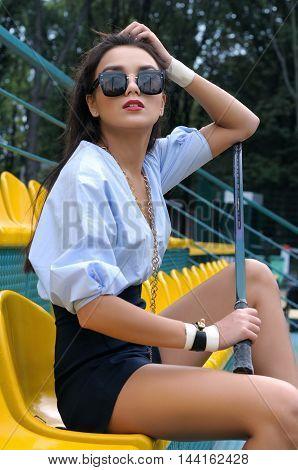 Tennis Player Sitting On The Platform
