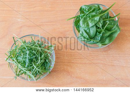 Healthy cups with ruccola and baby spinach