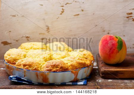 Peach cornmeal cobbler in the fraing pan . style vintage.. selective focus