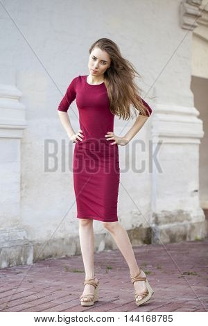 Portrait full length of young beautiful woman in red dress, summer outdoors