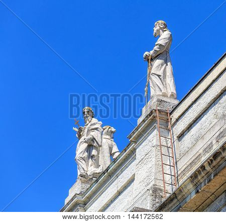 Solothurn, Switzerland - 10 July, 2016: statues on the roof of the St. Ursus Cathedral. The St. Ursus Cathedral, also called Cathedral of St. Ursus or Solothurn Cathedral, is a Swiss heritage site of national significance.