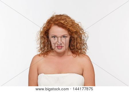 Beautiful woman doing different expressions in different sets of clothes: angry. Hatred woman posing isolated on white background.