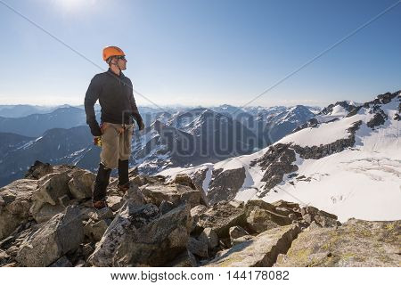 A mountain climber poses for a picture