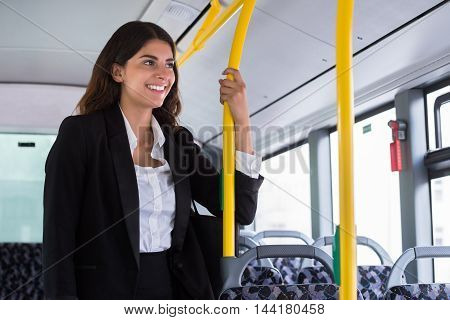 Happy Young Businesswoman Traveling By Public Transport