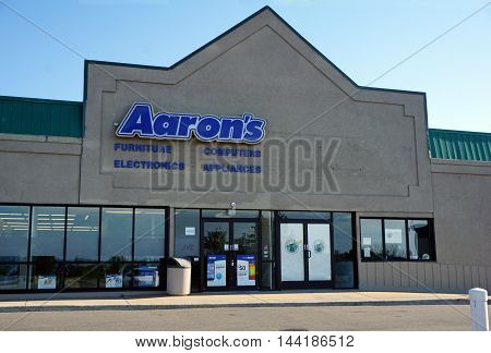 PETOSKEY, MICHIGAN / UNITED STATES - AUGUST 2, 2016: One buy or rent furniture, computers, appliances, and electronics at Aaron's, in Petoskey's Bay Mall.