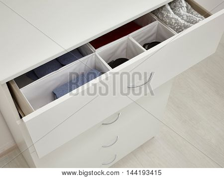 White drawer chest. Closeup fragment with props