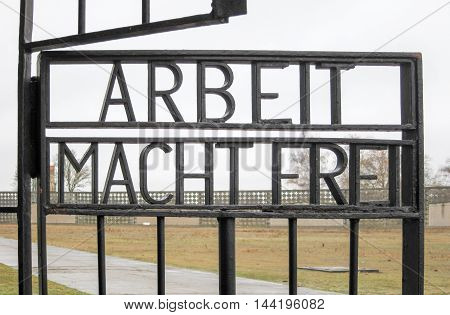 Inscription ARBEIT MACHT FREI on the gates to the former Nazi concentration camp now the Sachsenhausen National Memorial in Oranienburg Germany.