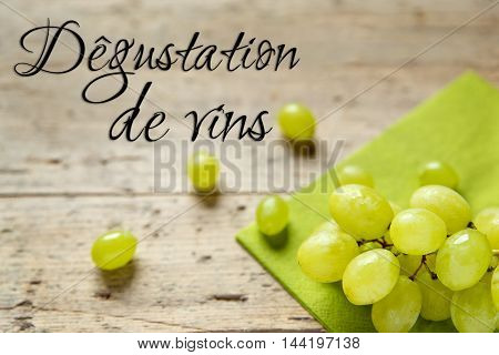 White Grapes On Wooden Table, French Text, Concept Wine Tasting