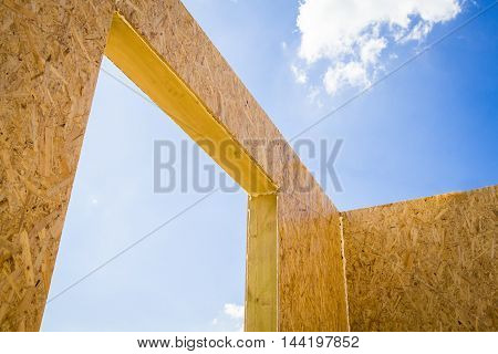 Part of a wooden being built house from SIP panels.